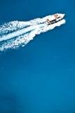 Boot op overzees Stock Foto's