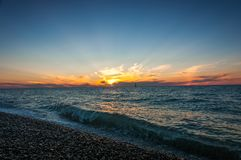 Boot in overzeese zonsondergang Stock Foto