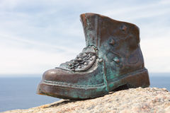 Boot pilgrim on the lighthouse of Cape Finisterre, Galicia, Spai Stock Photography