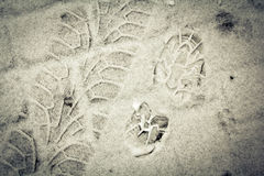 Boot print and tyre track on a snow Stock Images