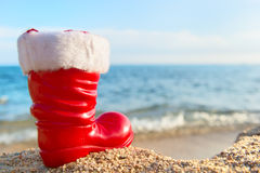 Boot Santa Claus at the beach. Funny boot of Santa Claus at the beach royalty free stock photo