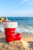 Boot Santa Claus at the beach. Funny boot of Santa Claus at the beach stock image