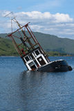 Boot, sinkend. Fischereifahrzeug, Loch Linnie Lizenzfreies Stockbild