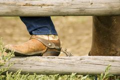 Boot with spur on rail fence Stock Photo
