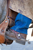 Boot with spur in the saddle Stock Photos