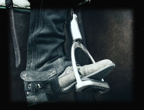 Boot in Stirrup. Holga effect image of a horse riders well worn boot in the stirrup royalty free stock photo