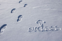 Boot Tracks Towards Success in Snow Stock Photo