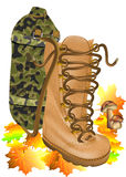 Boot traveling on autumn leves Royalty Free Stock Image