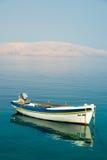 Boot und das Meer. Stockfotos