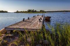 Boot und Pier Stockfotos