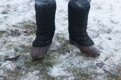 Boot valenki on the snow Stock Photo