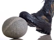 Boot on whimsical stone. Leather boot on whimsical stone stock photography