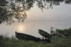 Boote an einem Sonnenaufgang Lizenzfreie Stockbilder