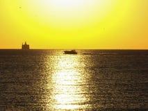 Boote und Lichtstrahlen Stockfotografie