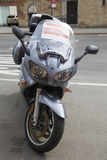 Booted illegally parked motorcycle in New York Stock Photography