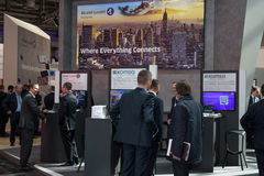 Booth of the company Alcatel Lucent with business men at CeBIT 2017 Royalty Free Stock Photos