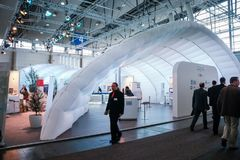 Booth House of CIOs at CeBIT information technology trade show. HANNOVER, GERMANY - MARCH 3, 2010: Booth House of CIOs at CeBIT information technology trade show stock photos