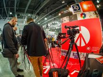 Booth of Manfrotto and Joby companies at PhotoForum 2018. MOSCOW, RUSSIA - APRIL 13, 2018: Booth of Manfrotto and Joby companies at PhotoForum 2018 trade show Stock Images