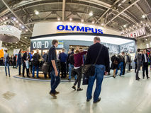 Booth of Olympus company at PhotoForum 2017 trade show. MOSCOW, RUSSIA - APRIL 21, 2017: Booth of Olympus company at PhotoForum 2017 trade show and exhibition in stock photography