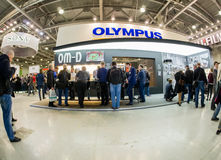 Booth of Olympus company at PhotoForum 2017 trade show. MOSCOW, RUSSIA - APRIL 21, 2017: Booth of Olympus company at PhotoForum 2017 trade show and exhibition in stock photo
