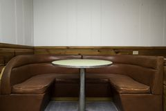 Booth Seats. Vintage booth seats for eating with white walls and wood Royalty Free Stock Photo