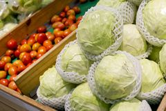 Booth with vegetables at the market, cabbages, tomatoes Royalty Free Stock Photo