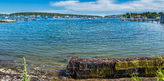 Boothbay Harbor Maine. Lobster traps wait along the shore of West Boothbay Harbor at Cape Newagen on the coast of Maine Royalty Free Stock Photos