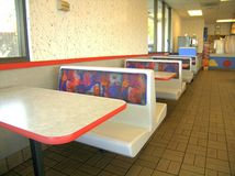 Booths. Hard plastic booths found in fast food dining room Stock Photo