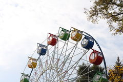 Booths of Ferris wheel at an autumn park. Royalty Free Stock Photos