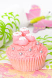 Booties Cupcake. Pink cupcake with sugar baby booties royalty free stock photo