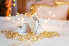 Booties girls are located on the bed among the ornaments stock photography
