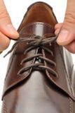 bootlace прикрепляет ботинки к Стоковые Изображения RF