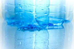 Bootle with water. Blue plastic effect with water Royalty Free Stock Images