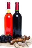 Bootles of wine with black grapes and a corkscrew Stock Image