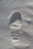 Bootprint i snön Arkivfoto