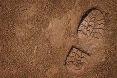 Bootprint na lama Imagens de Stock