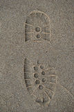 Bootprint in the sand. Print of a boot left in the sand stock photos