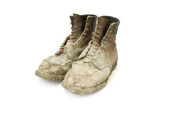 Boots. Pair of boots old and dirty on a white background Royalty Free Stock Photos