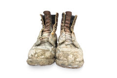 Boots. Pair of boots old and dirty on a white background Stock Photography