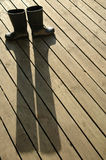 Boots. Wellington boots standing on a wooden deck. long shadows Stock Photography