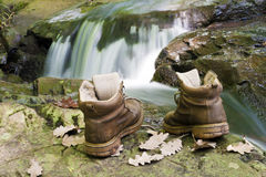 Boots. One pair of hiking boots river bank Royalty Free Stock Photo