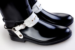 Boots. Black leather women's boots on a white background Royalty Free Stock Photo