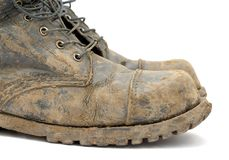 Boots. A pair of muddy boots Royalty Free Stock Photo