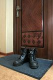 Boots. Man's boots near the door Royalty Free Stock Image