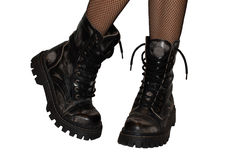 Boots. Girls foots in boots isolated royalty free stock image