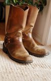 Boots. Warm Image Of Mens Western Boots On Rug With Natural Lighting From Glass Door royalty free stock photo