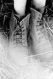 Vintage boots in straw Stock Images
