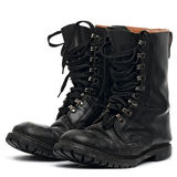 Boots. Black army worn boots on white Stock Photography