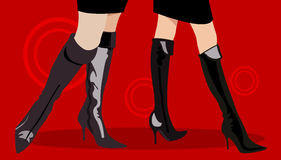 Boots. Legs of two women in sexy boots Stock Photos