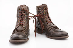 Boots. Brown boots connected by the laces, isolated Royalty Free Stock Photography